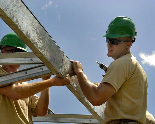 construction-worker-building-installing